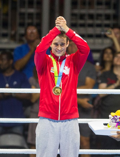 Canadian Arthur Biyarslanov celebrates winning gold over Yasnier Toledo of Cuba during Men�s Boxing Light Welter (64kg) Finals during Pan Am Games at Oshawa Sports Center in Oshawa, Ont. on Friday July 24, 2015. Ernest Doroszuk/Toronto Sun/Postmedia Network