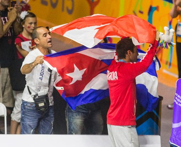 Cuban fan waves their flag at Canadian gold medalist Arthur Biyarslanov after beating Yasnier Toledo of Cuba during Men�s Boxing Light Welter (64kg) Finals during Pan Am Games at Oshawa Sports Center in Oshawa, Ont. on Friday July 24, 2015. Ernest Doroszuk/Toronto Sun/Postmedia Network