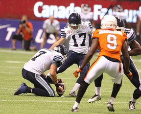 Toronto Argonauts Ronnie Pfeffer kick for a field goal during the second half of CFL action against BC Lions in Vancouver, B.C. on Friday July 24, 2015, Carmine Marinelli/Postmedia Network