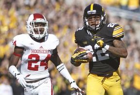 Wide receiver Damond Powell (right) of the Iowa Hawkeyes rushes for a touchdown as Tim Benneett of the Indiana Hoosiers chases during NCAA play at Kinnick Stadium in Iowa City last season. (Matthew Holst/Getty Images/AFP)