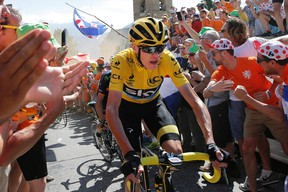 Chris Froome, wearing the overall leader's yellow jersey, climbs towards Alpe d'Huez during the 20th stage of the Tour de France Saturday, July 25, 2015. (AP Photo/Laurent Cipriani)