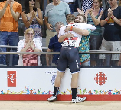 Hugo Barrette hugs family after he won gold in the men's sprint cycling final at the Pan Am Games on Saturday July 18, 2015. (MICHAEL PEAKE/Toronto Sun)