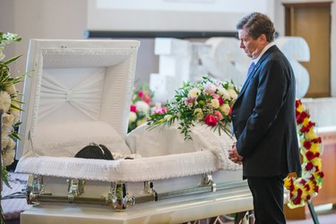 Toronto Mayor John Tory pays his respects at the funeral for Lecent Ross, 14, at Abundant Life Assembly church in Toronto, Ont. on Saturday July 25, 2015. Ross died when an illegal handgun discharged.  Ernest Doroszuk/Toronto Sun/Postmedia Network