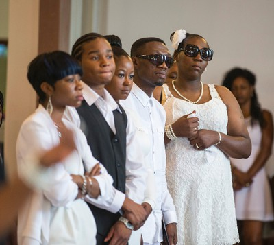 Family and friends say goodbye at the funeral for Lecent Ross, 14, at Abundant Life Assembly church in Toronto, Ont. on Saturday July 25, 2015. Ross died when an illegal handgun discharged.  Ernest Doroszuk/Toronto Sun/Postmedia Network