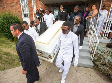 The casket is carried out during the funeral for Lecent Ross, 14, at Abundant Life Assembly church in Toronto, Ont. on Saturday July 25, 2015. Ross died when an illegal handgun discharged.  Ernest Doroszuk/Toronto Sun/Postmedia Network