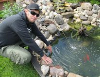 Ryan Spratt likes waterfalls. A lot of his farmer friends wanted to get rid of some rocks. That was Ryan's inspiration to build a backyard fish pond. (Ted Meseyton/Submitted photo)