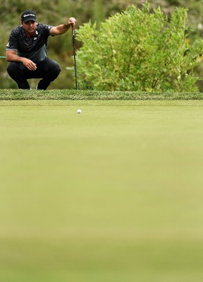 Australian Jason Day lines up a putt during Saturday's round at the Canadian Open at Glen Abbey. (AFP/PHOTO)