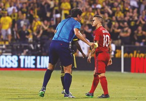Toronto FC's Sebastian Giovinco gets face-to-face with referee Fotis Bazakos during last night's game in Columbus. Giovinco scored one goal in the 3-3 draw. (USA TODAY SPORTS)