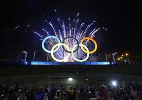 A picture of the inauguration of the first Olympic rings at Madureira Park, suburbian Rio de Janeiro, Brazil on May 20, 2015. The Olympic Games will take place in Rio in August 2016. (AFP PHOTO)