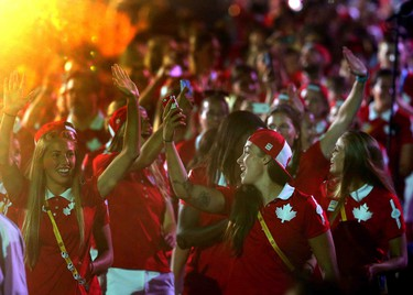 Canadian athletes take to the field during the parade of nations during the closing ceremonies of the 2015 Pan Am games in Toronto, Ont. on Sunday July 26, 2015. Dave Abel/Toronto Sun/Postmedia Network