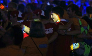 Canadian athletes take in the closing ceremonies of the 2015 Pan Am games in Toronto, Ont. on Sunday July 26, 2015. Dave Abel/Toronto Sun/Postmedia Network