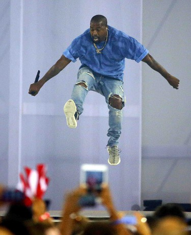 Kanye West performs during the closing ceremonies of the 2015 Pan Am games in Toronto, Ont. on Sunday July 26, 2015. Dave Abel/Toronto Sun/Postmedia Network