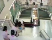 A Chinese woman died after being trapped in an escalator at a shopping mall. (YouTube screengrab)