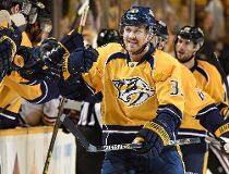 Colin Wilson #33 of the Nashville Predators is congratulated by teammates after scoring a power play goal against the Chicago Blackhawks during the third period of Game Five of the Western Conference Quarterfinals during the 2015 NHL Stanley Cup Playoffs