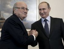 Russian President Vladimir Putin (R) shakes hands with FIFA president Sepp Blatter during a meeting in St. Petersburg, Russia, July 25, 2015.  (REUTERS/Maxim Shipenkov/Pool)