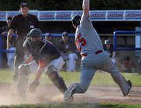 Brantford's Nick Burdett, shown stretching past Barrie catcher Kyle DeGrace to score, is the Intercounty Baseball League batter of the week.(Postmedia file photo)