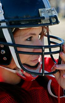 In this Feb. 12, 2014, photo, Jen Welter puts her helmet on before the start of the Texas Revolution practice at Bradford Crossing Park in Allen, Texas. The Arizona Cardinals have hired Welter to coach inside linebackers through their upcoming training ca