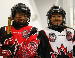 Leighanna Rizarri, 9, left, and Laralee Rizarri, 8, right, will be travelling with the AAA Cowboys, compiled of 2005-2006 born hockey players in August 2016 to play exhibition games in Europe. The sisters, during a break in practice on Friday July 24, 2015 at the Crosslink County Sportsplex, five kilometres north of Grande Prairie, Alta, were scouted to the team. Logan Clow/Grande Prairie Daily Herald-Tribune/Postmedia Network