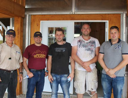 Hannibal Muhtar, Andrew Muhtar, Rob Visscher, Bernhard Visscher and Alex Visscher (left to right). The Visscher brothers opened up their farm to visiting agricultural researchers on July 28. (MEGAN STACEY/Sentinel-Review)