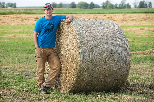 Dairy farmer Andrew Campbell spent the day baling hay in Kerwood, Ont. on Tuesday. (DEREK RUTTAN, The London Free Press)