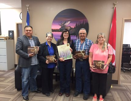 Kathleen Ganley, minister for aboriginal relations and justice, poses with Metis leaders from Fort McMurray, Fort McKay, Fort Chipewyan and Conklin following a meeting in Fort McMurray, Alta. on July 28, 2015. Supplied Image
