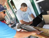 A lake trout is weighed by Bob Bell at the Wiarton weigh-in station located at the Spirit Rock Lodge and Outpost, on top on the north hill. MNR reps were on-site taking scale and stomach samples – as well as cleaning the catches. NELSON PHILLIPS/WIARTON ECHO PHOTOS