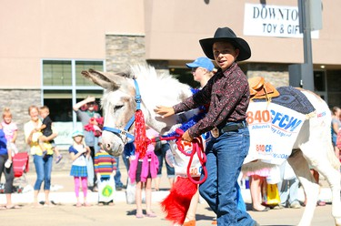 The 840 CFCW AM float went all country while promoting their new frequency during the Big Valley Jamboree kick off parade July 30.  AMIELLE CHRISTOPHERSON/CAMROSE CANADIAN/POSTMEDIA NETWORK