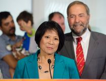 Olivia Chow, left, and NDP Leader Tom Mulcair hold a press conference in Toronto on Tuesday, July 28, 2015. Former MP Olivia Chow is making a comeback to the NDP ahead of the upcoming federal election. Chow announced she's running in the Toronto riding of Spadina-Fort York. THE CANADIAN PRESS/Darren Calabrese