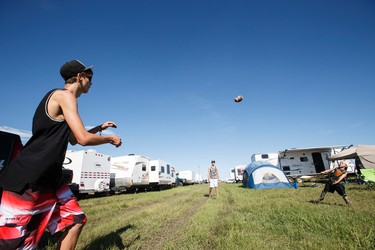 Edmontonians Brock Delorme, 17, (left), Jaden Delorme (centre), 16, and Ryan Blake, 6, play football at their family campsite during Big Valley Jamboree 2015 in Camrose, Alta. on Thursday July 30, 2015. Ian Kucerak/Edmonton Sun/Postmedia Network