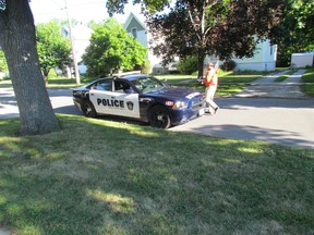 Sarnia Police investigate a sudden death Friday July 31, 2015 on Kathleen Avenue in Sarnia, Ont. A passerby noticed a man on the ground early Friday morning. Paul Morden/Sarnia Observer/Postmedia Network