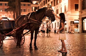 There's magic afoot when you sightsee at night in Rome, as this young girl discovers near the Spanish Steps. DOMINIC ARIZONA BONUCCELLI PHOTO