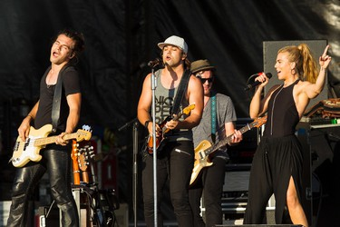 The Band Perry, including Kimberly Perry (right), Reid Perry (left) and Neil Perry, perform on the main stage during Big Valley Jamboree 2015 in Camrose, Alta. on Friday July 31, 2015. Ian Kucerak/Edmonton Sun/Postmedia Network