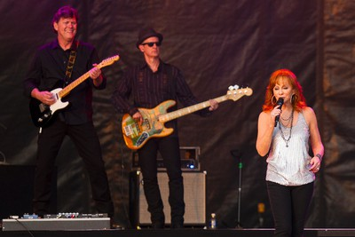 Reba McEntire (right) performs on the main stage during Big Valley Jamboree 2015 in Camrose, Alta. on Friday July 31, 2015. Ian Kucerak/Edmonton Sun/Postmedia Network