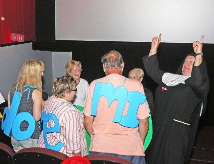 Dressed as a nun, Paul Coates leads a group of costumed participants in a tune from The Sound of Music Saturday during a sing-along showing of the movie at the Stratford Cinemas. The event was hosted by Stratford Summer Music. MIKE BEITZ/The Beacon Herald