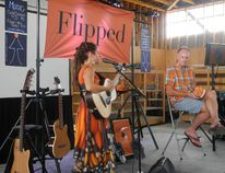 Singer-songrwriter Heatherlyn performs some inspirational tunes while author Doug Pagitt reads from his new book Flipped: The Provocative Truth That Changes Everything We Know About God, at the Skylight Festival at the Paris Fairgrounds on the civic holiday weekend.