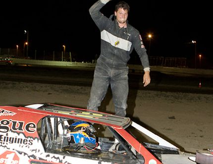 Kyle Hope of Blenheim waves the checkered flag after winning the Mini-Mods feature Saturday night at South Buxton Raceway. (JAMES MACDONALD/Special to The Daily News)