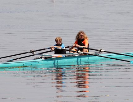 STEPHEN UHLER / DAILY OBSERVER Rudy Saal, left, and Andrew Biernacki operate a two-person racing shell during the youth camp hosted by the Upper Ottawa Valley Boat Club at Riverside Park last week.
