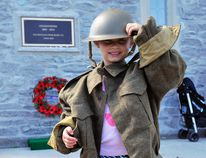 Ellie Paulmert, 5, gives her best salute at the base of the Carillon Tower during the structure's 90th anniversary celebration Saturday. To add to the party, a new 60-page book entitled 'Letters Home: The Beginning 1914-15' was launched. (JACOB ROBINSON Simcoe Reformer)