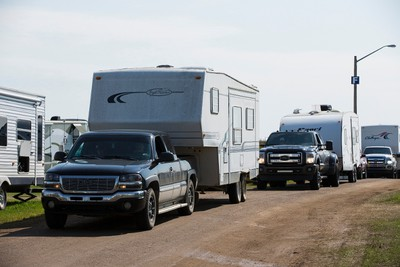 Trucks and trailers slowly exit the campgrounds while heading home after Big Valley Jamboree 2015 in Camrose, Alta. on Monday August 3, 2015. Ian Kucerak/Edmonton Sun/Postmedia Network