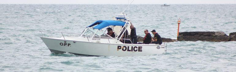 The OPP Marine Unit is seen searching Lake Huron along the Kincardine breakwall, a few hundred metres where 16-year-old Lucas Johnson of Goderich went missing while swimming there Sunday afternoon and is presumed drowned. (TROY PATTERSON/KINCARDINE NEWS)