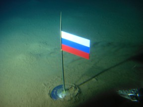 In this Thursday, Aug. 2, 2007 file made available by the Association of Russian Polar Explorers on Wednesday, Aug. 8, 2007, photo a titanium capsule with the Russian flag is seen seconds after it was planted by the Mir-1 mini submarine on the Arctic Ocean seabed under the North Pole during a record dive. (AP Photo/Association of Russian Polar Explorers, file)
