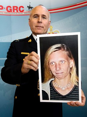 RCMP Inspector Gibson Glavin holds a photo of Corrie Renee Ottenbreit following a press conference at RCMP K Division, in Edmonton on July 28, 2015. (David Bloom/Postmedia Network)
