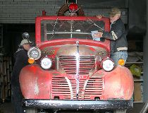Volunteers Dave Reimer (l) and Leon St. Onge prepare a 1939 Fargo firetruck at the St. Vital Museum in Winnipeg, Man. Monday September 29, 2014 for a drive to its winter storage compound.