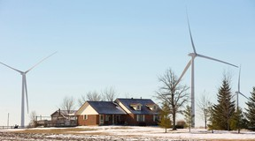 Homes near Kerwood have wind turbines in view west of London, Ont. on Wednesday January 28, 2015.