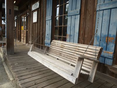 Wooden swing bench on the porch of HJ Smith's Sons General Store and Museum in Covington, La. The small city on the north shore of Lake Pontchartrain is a popular getaway from New Orleans. ROBIN ROBINSON/TORONTO SUN