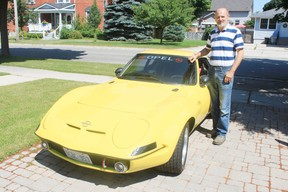 Goderich resident PJ Romano stands with his classic 1972 Opel GT. Romano retired on June 30 after more than 40 years in the grader sales industry, including 30 years at the Goderich plant. The same day, Volvo produced its at last grader at its Shippensburg, PA plant.