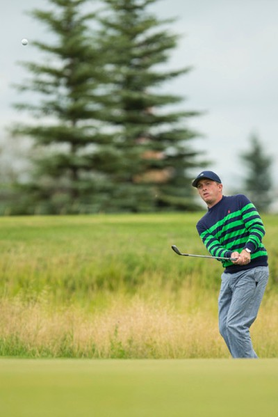 Kevin Black chips from the rough on Hole 9 during PGA Alberta Players Tour play at RedTail Landing Golf Club in Nisku, Alta., on Tuesday August 4, 2015. Ian Kucerak/Edmonton Sun/Postmedia Network