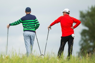 Kevin Black (left) and Mike Belbin watch as Kevin Chow tees off on Hole 10 during PGA Alberta Players Tour play at RedTail Landing Golf Club in Nisku, Alta., on Tuesday August 4, 2015. Ian Kucerak/Edmonton Sun/Postmedia Network
