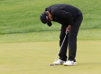 Mike Belbin reacts after missing a put on the 18th hole during the final round of the Players' Tour RedTail Landing event, in Edmonton Alta. on Wednesday Aug. 5, 2015. David Bloom/Edmonton Sun/Postmedia Network