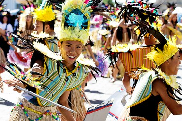 Dancers from the Philippine Barangay Performing Arts Society take part in the Cariwest Parade, in downtown Edmonton Alta. on Saturday Aug. 8, 2015. David Bloom/Edmonton Sun/Postmedia Network